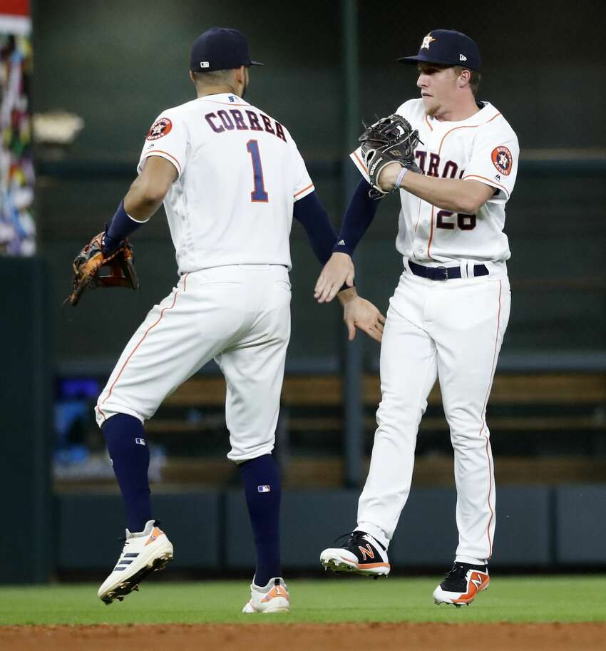Houston Astros Carlos Correa (1) celebrates with Myles Straw after the Astros 10-4 win over the Arizona Diamondbacks during an MLB game at Minute Maid Park, Saturday, September 15, 2018, in Houston.