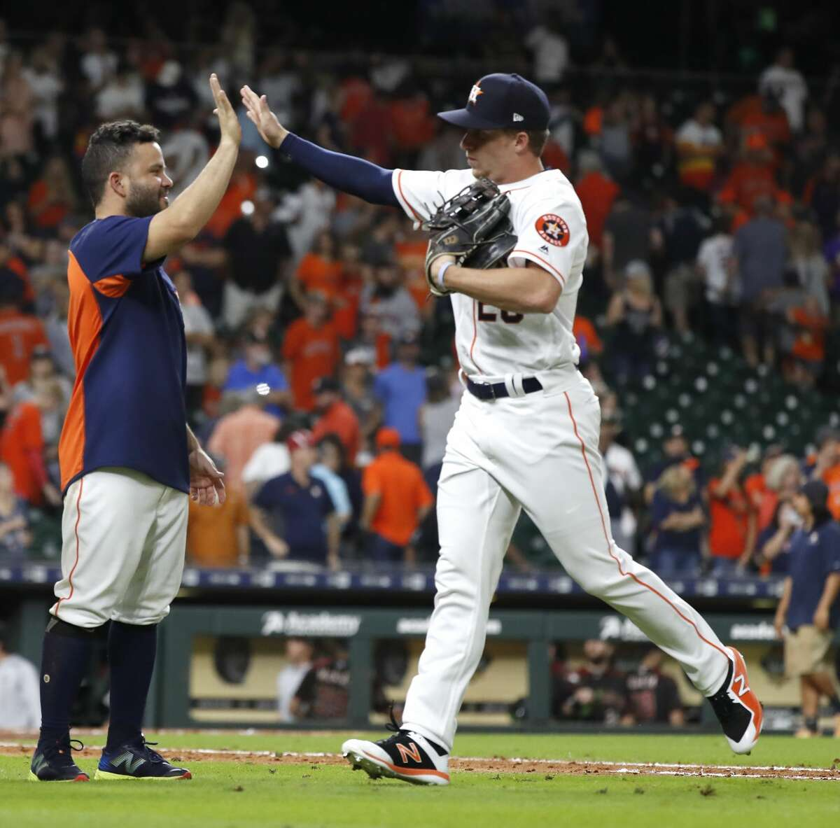 Houston Astros Jose Altuve (27) celebrated with Myles Straw after the Astros 10-4 win over the Arizona Diamondbacks during an MLB game at Minute Maid Park, Saturday, September 15, 2018, in Houston.
