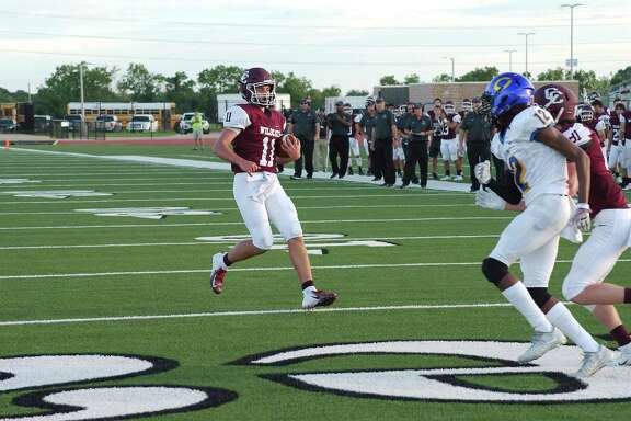 Clear Creek's Hunter Smith (11) jogs into the end zone for a touchdown against Channelview Saturday at CCISD Challenger Columbia Stadium.