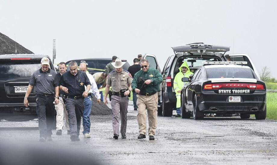 Webb County District Attorney Chilo Alaniz and Webb County Sheriff Martin Cuellar along with other law enforcement representatives walk away from the scene where a fourth body was found on Sept. 15, 2018. Officials say she was the victim of a serial killer and have charged Border Patrol agent Juan David Ortiz with four counts of murder. Photo: Danny Zaragoza /Laredo Morning Times