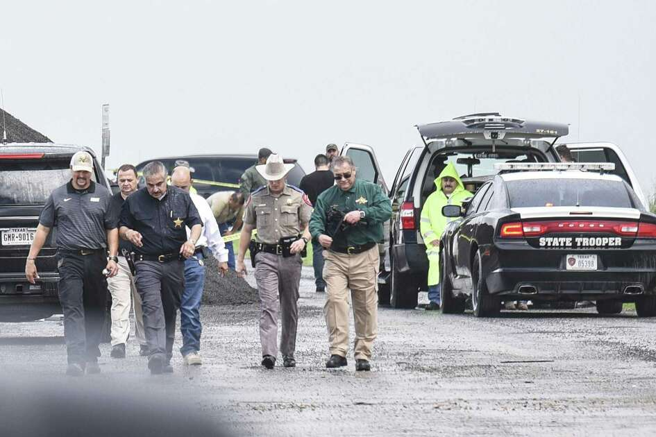 Webb County District Attorney Chilo Alaniz and Webb County Sheriff Martin Cuellar along with other law enforcement representatives walk away from the scene where a fourth body was found on Sept. 15, 2018. Officials say she was the victim of a serial killer and have charged Border Patrol agent Juan David Ortiz with four counts of murder.