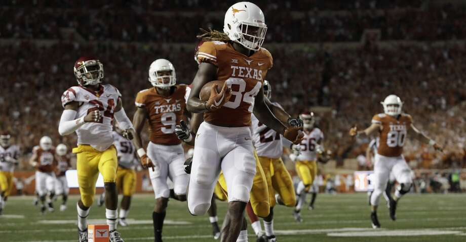 AUSTIN, TX - SEPTEMBER 15:  Lil'Jordan Humphrey #84 of the Texas Longhorns catches a pass and runs for a touchdown in the second quarter defended by Marvell Tell III #7 of the USC Trojans and Isaiah Langley #24 at Darrell K Royal-Texas Memorial Stadium on September 15, 2018 in Austin, Texas.  (Photo by Tim Warner/Getty Images) Photo: Tim Warner/Getty Images