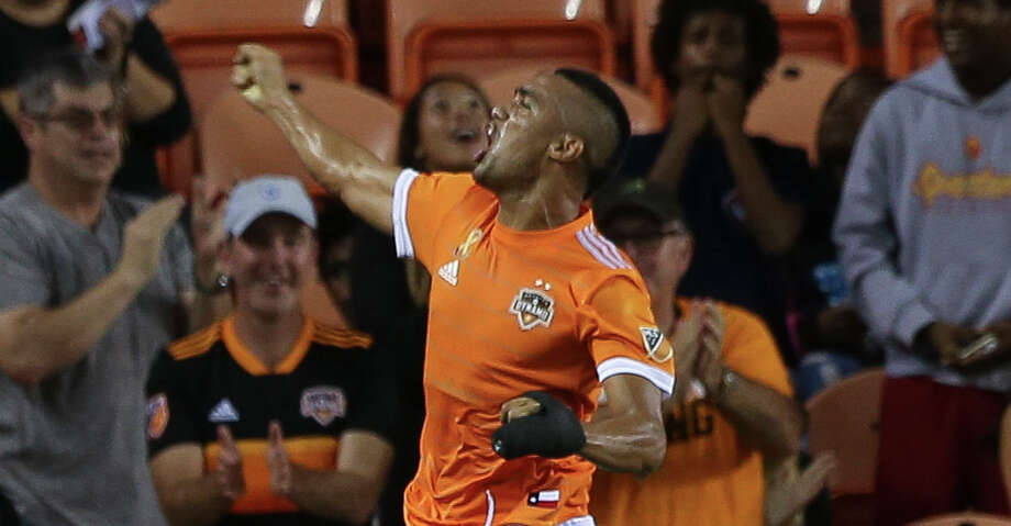 Houston Dynamo forward Mauro Manotas (9) leaps into the air to celebrate his goal at the 39th minute of the first half of the MLS game against the Portland Timbers at BBVA Compass Stadium on Saturday, Sept. 15, 2018, in Houston. Photo: Yi-Chin Lee/Staff Photographer / © 2018 Houston Chronicle