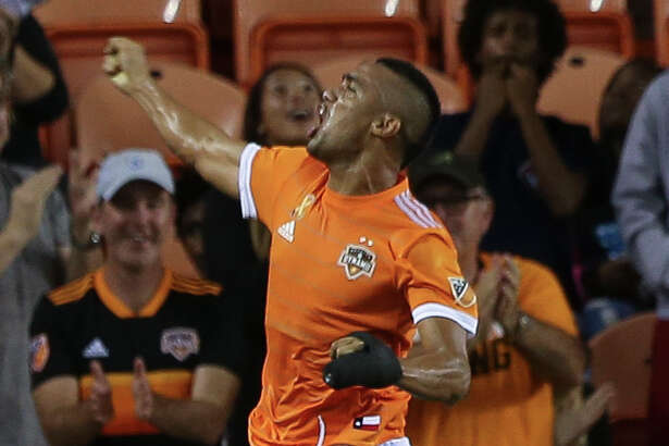 Houston Dynamo forward Mauro Manotas (9) leaps into the air to celebrate his goal at the 39th minute of the first half of the MLS game against the Portland Timbers at BBVA Compass Stadium on Saturday, Sept. 15, 2018, in Houston.