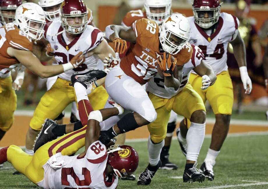 Longhorn running back Daniel Young breaks through the middle in the second quarter as UT plays USC at DKR Stadium on September 15, 2018. Photo: Tom Reel, Staff / Staff Photographer / 2017 SAN ANTONIO EXPRESS-NEWS