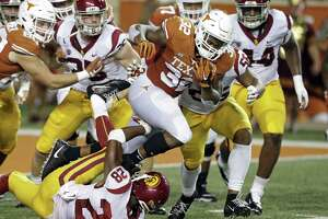 Longhorn running back Daniel Young breaks through the middle in the second quarter as UT plays USC at DKR Stadium on September 15, 2018.