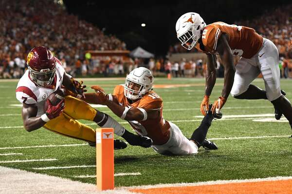 USC running back Stephen Carr is stopped at the 3-yard line on 4th and goal as Texas defensive back Brandon Jones (19) makes the stop in the second quarter at Royal-Texas Memorial Stadium in Austin, Texas, on Saturday, Sept. 15, 2018. (Wally Skalij/Los Angeles Times/TNS)