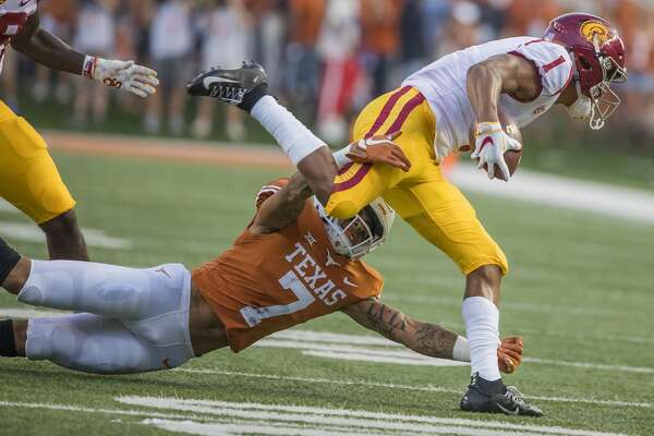 Texas defensive back Caden Sterns (7) stops USC wide receiver Velus Jones Jr. (1) for a loss on the first play of the game at Royal-Texas Memorial Stadium in Austin, Texas, on Saturday, Sept. 15, 2018. (Ricardo B. Brazziell/Austin American-Statesman/TNS)