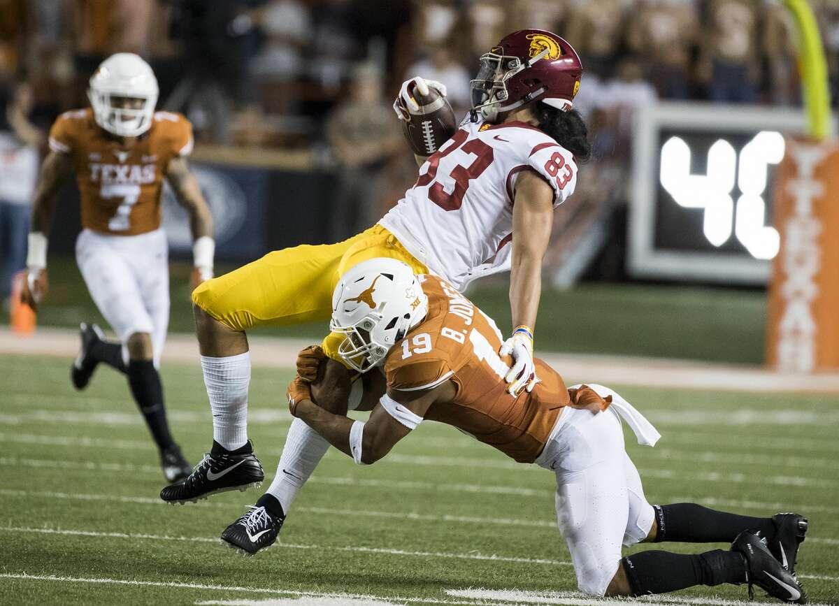 Texas defensive back Brandon Jones (19) brings down USC tight end Josh Falo (83) in the second quarter at Royal-Texas Memorial Stadium in Austin, Texas, on Saturday, Sept. 15, 2018. (Ricardo B. Brazziell/Austin American-Statesman/TNS)