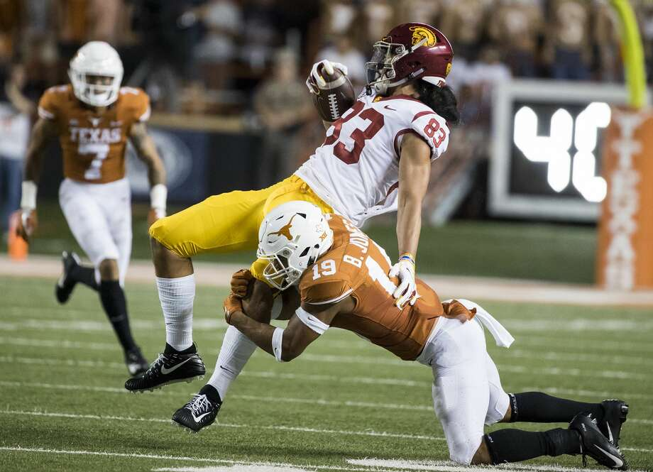 Texas defensive back Brandon Jones (19) brings down USC tight end Josh Falo (83) in the second quarter at Royal-Texas Memorial Stadium in Austin, Texas, on Saturday, Sept. 15, 2018. (Ricardo B. Brazziell/Austin American-Statesman/TNS) Photo: RICARDO B. BRAZZIELL/TNS