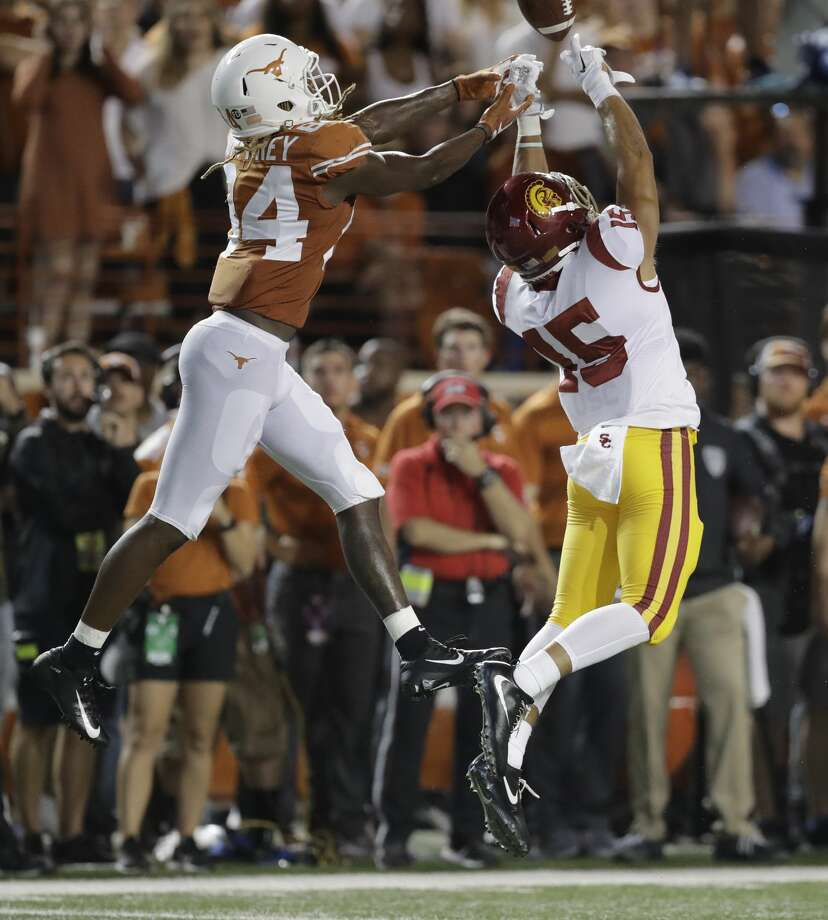 Southern California safety Talanoa Hufanga (15) breaks up a pass intended for Texas Longhorns wide receiver Lil'Jordan Humphrey (84) during the first half of an NCAA college football game, Saturday, Sept. 15, 2018, in Austin, Texas. (AP Photo/Eric Gay) Photo: Eric Gay/Associated Press