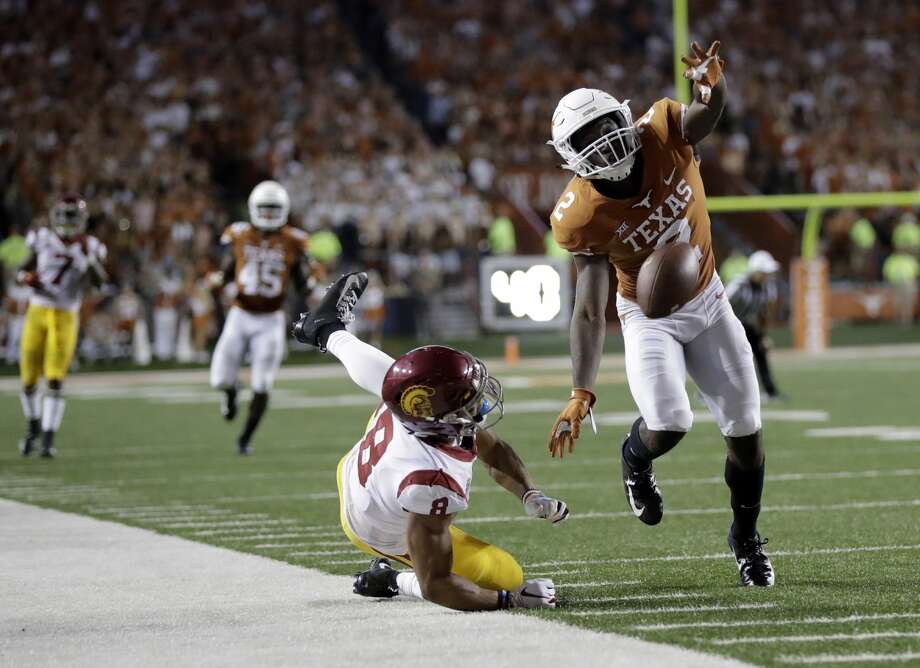 PHOTOS: What to know about Texans top-draft pick Tytus Howard  Texas defensive back Kris Boyd (2) breaks up a pass intended for Southern California wide receiver Amon-Ra St. Brown (8) during the second half of an NCAA college football game, Saturday, Sept. 15, 2018, in Austin, Texas. (AP Photo/Eric Gay) >>>Learn more about the Texans' top-draft pick ...  Photo: Eric Gay/Associated Press