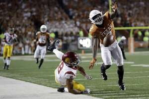 Texas defensive back Kris Boyd (2) breaks up a pass intended for Southern California wide receiver Amon-Ra St. Brown (8) during the second half of an NCAA college football game, Saturday, Sept. 15, 2018, in Austin, Texas. (AP Photo/Eric Gay)