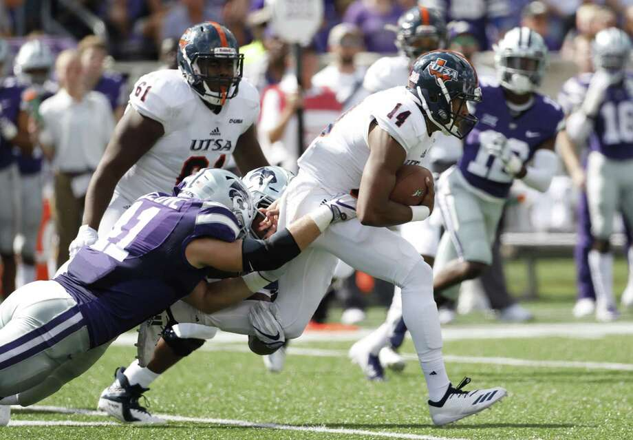 UTSA quarterback Cordale Grundy (14) fights for yardage as Kansas State linebacker Sam Sizelove (41) tries to bring him down. Grundy passed for 108 yards and a touchdown. Photo: Colin E. Braley /Associated Press / Copyright 2018, The Associated Press