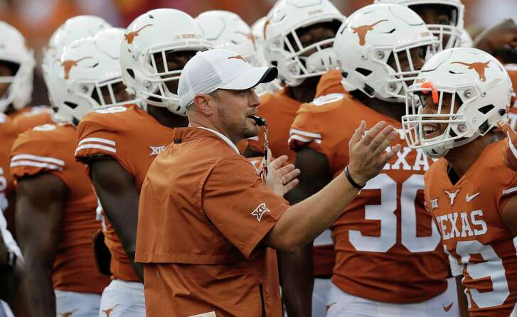 Texas head coach Tom Herman, center, rallies his team before an NCAA college football game against USC, Saturday, Sept. 15, 2018, in Austin, Texas. (AP Photo/Eric Gay)