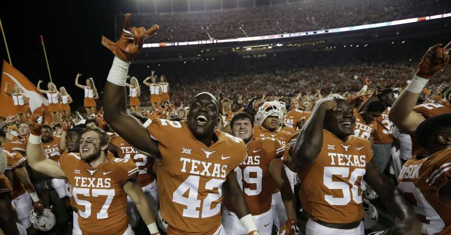 Texas players celebrate their 37-14 win over USC in an NCAA college football game, Saturday, Sept. 15, 2018, in Austin, Texas. (AP Photo/Eric Gay) Photo: Eric Gay/Associated Press