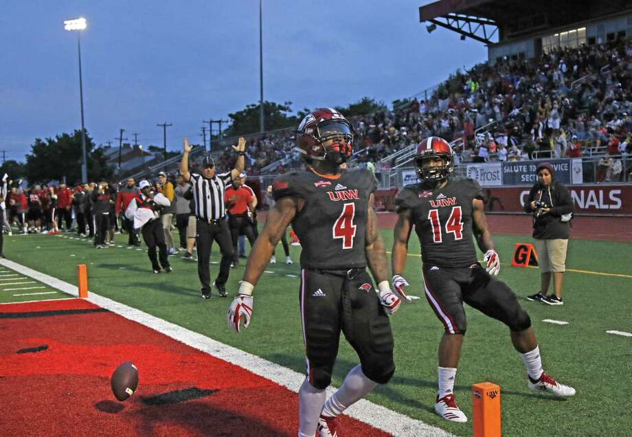 IWC's RaQuanne Dickens scores on a long TD run against Stephen F. Austin as teammate Kam Williams celebrates with him. Stephen F. Austin at Incarnate Word at Benson Stadium on Saturday, September 15, 2018. Photo: Ronald Cortes, Photo Correspondent / 2018 Ronald Cortes