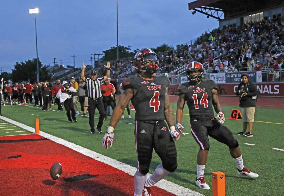 UIW's Ra'Quanne Dickens scores on a long TD run against Stephen F. Austin as teammate Kam Williams celebrates with him. Stephen F. Austin at Incarnate Word at Benson Stadium on Saturday, September 15, 2018.