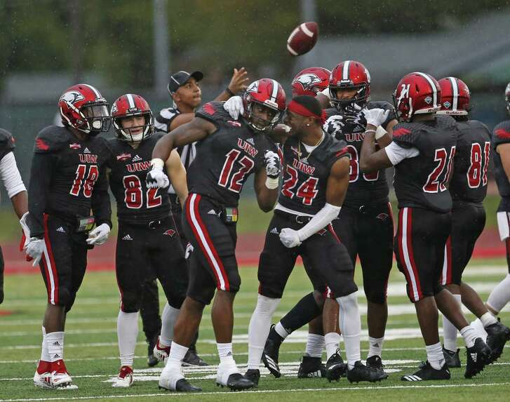 Incarnate Word's Silas Steward, 12, celebrates with Javon Burse after an interception during a game against Stephen F. Austin on Saturday, September 15, 2018, at Gayle and Tom Benson Stadium.