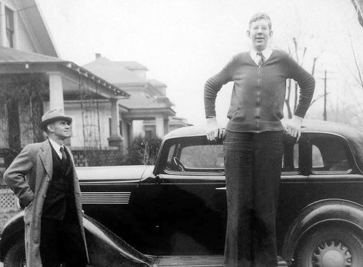 FILE - Robert Wadlow, Alton's gentle giant, poses for a photo with Telegraph city editor J.J. Dromgoole in February 1937. The editor was 6 feet tall when the photo was snapped.