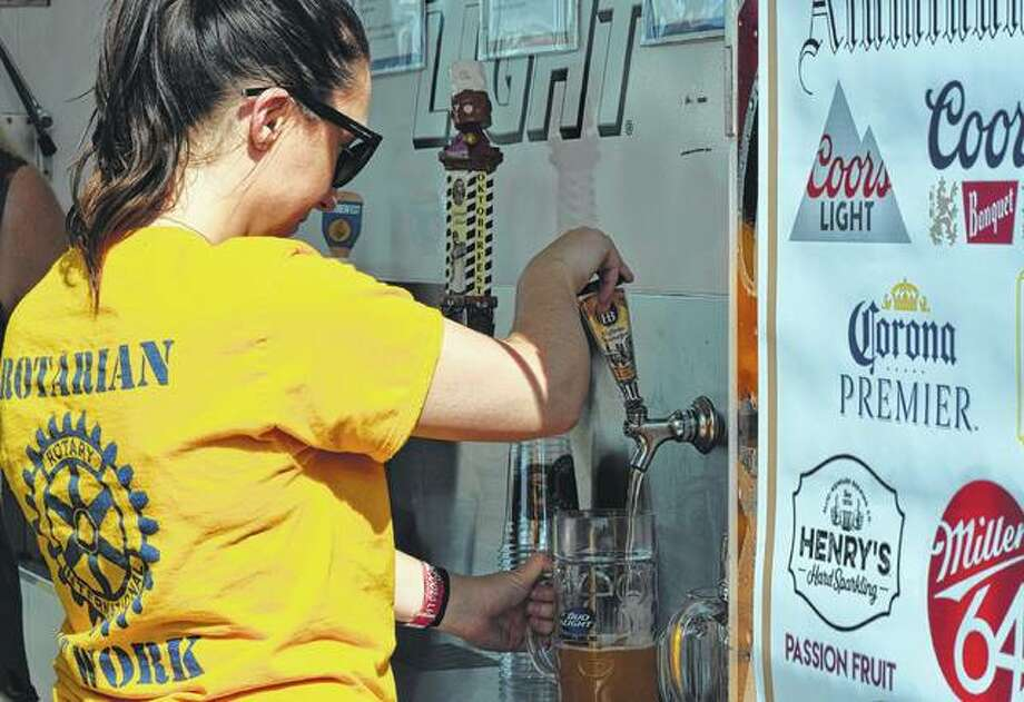 Jacksonville Rotarian Jenna Tucker pours a beer Saturday at the Rotary Club's Oktoberfest. Photo: Samantha McDaniel-Ogletree | Journal-Courier