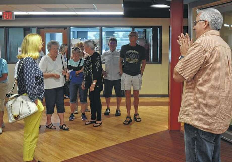 Jacksonville District 117 Superintendent Steve Ptacek (right) gives a tour of Jacksonville Middle School to the class of 1961 Saturday.