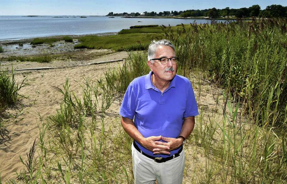 George Krall, Guilford town planner, at Chittenden Park Beach by the salt marsh near the West River and Chaffinch Island Park in Guilford. Guilford has been in the forefront of preparing for climate change and rising sea levels. Photo: Peter Hvizdak / Hearst Connecticut Media / New Haven Register