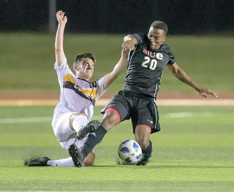SIUE's Cliff Maina (right) beats a Loyola player to the ball during a college men's soccer match Saturday night at Korte Stadium in Edwardsville. Photo: SIUE Athletics