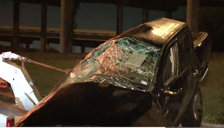 A woman survived an overnight wreck after her car veered off the Gulf Freeway. Photo: Metro Video