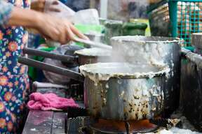 The preparation of rice porridge in the morning
