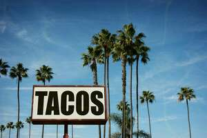 aged and worn tacos sign