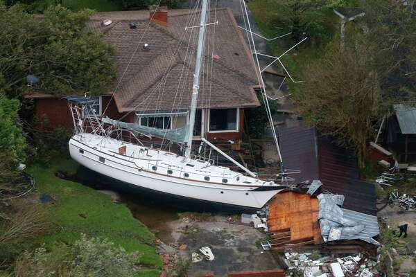 A sailboat is shoved up against a house and a collapsed garage Saturday, Sept. 15, 2018, after heavy wind and rain from Florence, now a tropical storm, blew through New Bern, N.C.