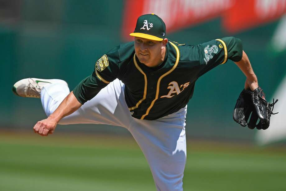 Oakland Athletics pitcher Trevor Cahill (53) pitches against the Houston Astros in the first inning on Saturday, Aug. 18, 2018 at the Oakland Coliseum in Oakland, Calif. Oakland defeated Houston 7-1. (Jose Carlos Fajardo/Bay Area News Group/TNS) Photo: JOSE CARLOS FAJARDO / TNS