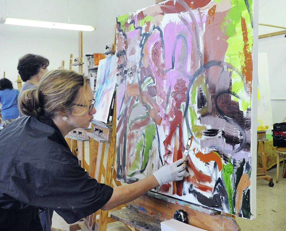 Oli Kambeitz of Greenwich works on her oil painting during a master painting class in contemporary issues with a focus on abstraction and non-objective painting taught by Anna Patalano at the Greenwich Art Society last year. Fall classes begin Monday at the Studio School, which is rooted in the teaching ideology of its founding members in the Cos Cob Colony of Artists. Photo: File / Bob Luckey Jr. / Hearst Connecticut Media / Greenwich Time