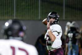 J.D. Head (12) of Pearland eyes Malcolm Linton (13) for a pass in the third quarter of a high school football game between Cinco Ranch and Pearland Saturday in Katy.