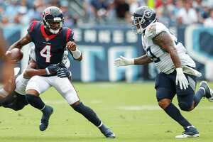 Houston Texans quarterback Deshaun Watson (4) is chased out of the pocket by Tennessee Titans linebacker Wesley Woodyard and defensive tackle Jurrell Casey (99) during the first quarter of an NFL football game at Nissan Stadium on Sunday, Sept. 16, 2018, in Nashville.