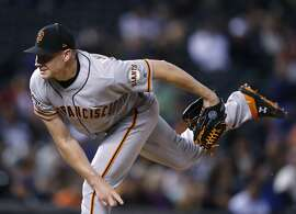 San Francisco Giants relief pitcher Mark Melancon watches a throw to a Colorado Rockies batter during the seventh inning of a baseball game Wednesday, Sept. 5, 2018, in Denver. (AP Photo/David Zalubowski)