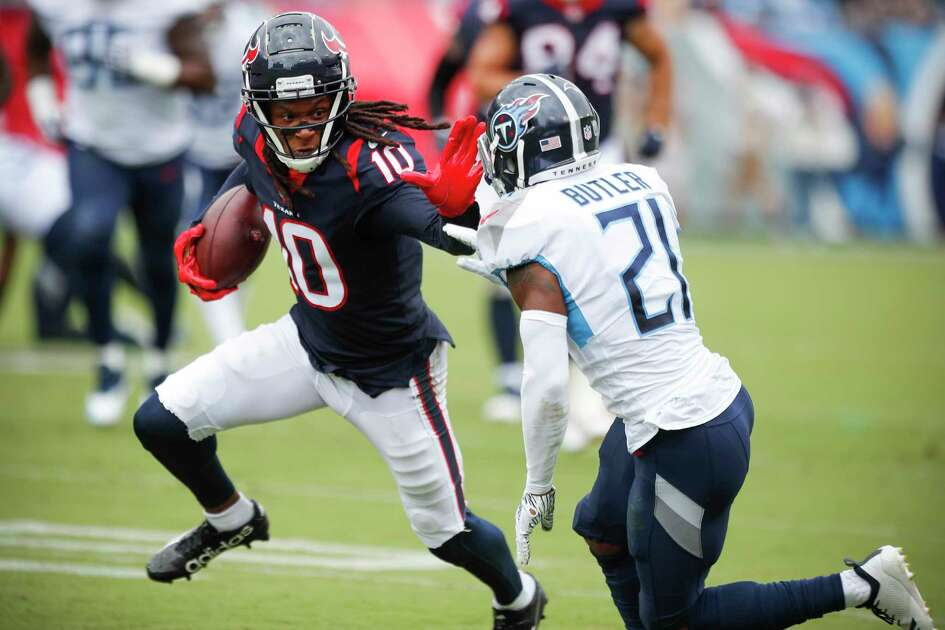 Houston Texans wide receiver DeAndre Hopkins (10) runs the ball against Tennessee Titans defensive back Malcolm Butler (21) during the second quarter of an NFL football game at Nissan Stadium on Sunday, Sept. 16, 2018, in Nashville.