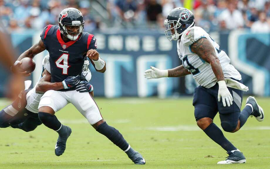 Houston Texans quarterback Deshaun Watson (4) is chased out of the pocket by Tennessee Titans linebacker Wesley Woodyard and defensive tackle Jurrell Casey (99) during the first quarter of an NFL football game at Nissan Stadium on Sunday, Sept. 16, 2018, in Nashville. Photo: Brett Coomer, Staff Photographer / © 2018 Houston Chronicle