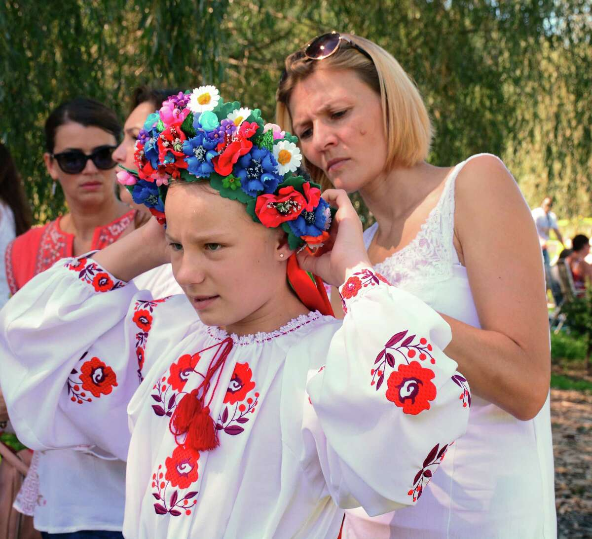 Olessia Tataryn,11, from Stamford gets help with her headpiece from Ruslana Tataryn also from Stamford. The Kalunonka Dance Troop, from Stamford, performed during the 43rd Annual Ukranian Festival was held on Sunday September 16, 2016 at Paproski Castle Hill Farm and Pumpin Patch in Newtown.