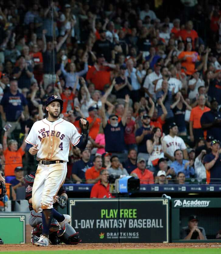 Houston Astros George Springer (4) celebrates as he crosses the plate scoring a run on Houston Astros Tyler White's ground rule double during the sixth inning  of an MLB game at Minute Maid Park, Sunday, September 16, 2018, in Houston.