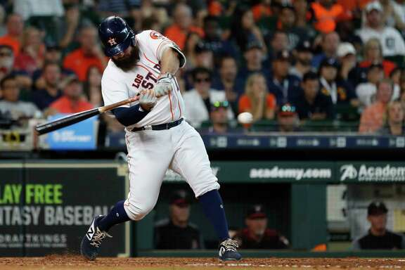 Houston Astros Tyler White (13) hits a  ground-rule double during the sixth inning of an MLB game at Minute Maid Park, Sunday, September 16, 2018, in Houston.