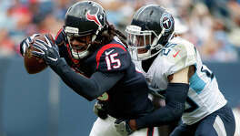Houston Texans wide receiver Will Fuller (15) is tackled by Tennessee Titans cornerback Adoree' Jackson (25) during an NFL football game Sunday, Sept. 16, 2018, in Nashville, Tenn. (Austin Anthony /Daily News via AP)