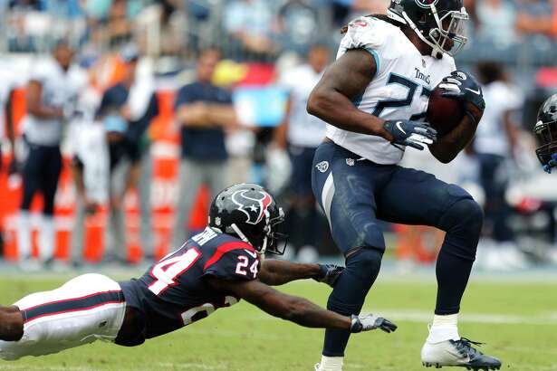 Tennessee Titans running back Derrick Henry (22) breaks away from Houston Texans defensive back Johnathan Joseph (24) during the second quarter of an NFL football game at Nissan Stadium on Sunday, Sept. 16, 2018, in Nashville.