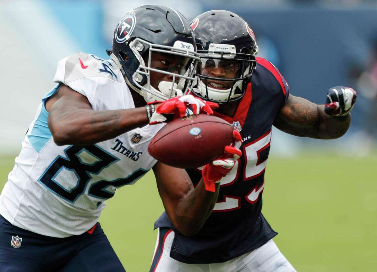 Tennessee Titans wide receiver Corey Davis (84) makes a reception against Houston Texans defensive back Kareem Jackson (25) during the second quarter of an NFL football game at Nissan Stadium on Sunday, Sept. 16, 2018, in Nashville.