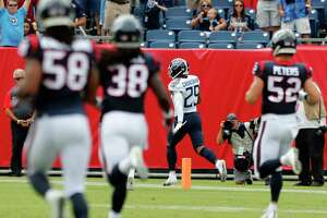 Tennessee Titans defensive back Dane Cruikshank (29) runs to a 66-yard touchdown reception on a fake punt against the Houston Texans during the first quarter of an NFL football game at Nissan Stadium on Sunday, Sept. 16, 2018, in Nashville.