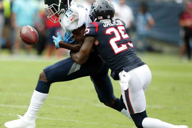 Houston Texans defensive back Kareem Jackson (25) breaks up a pass intended for Tennessee Titans wide receiver Taywan Taylor (13) during the second quarter of an NFL football game at Nissan Stadium on Sunday, Sept. 16, 2018, in Nashville.