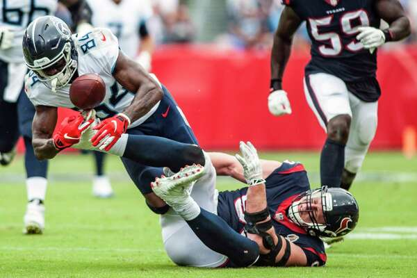 Houston Texans defensive end J.J. Watt (99) forces Tennessee Titans wide receiver Corey Davis (84) to fumble using his foot during an NFL football game Sunday, Sept. 16, 2018, in Nashville, Tenn. (Austin Anthony/Daily News via AP)