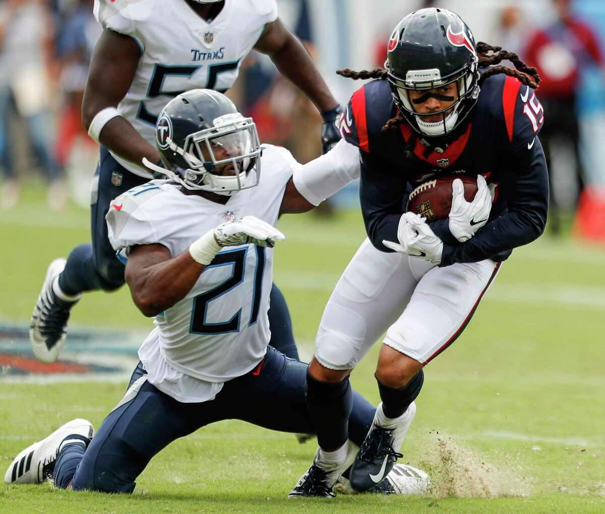 Houston Texans wide receiver Will Fuller (15) makes a catch against Tennessee Titans defensive back Malcolm Butler (21) during the third quarter of an NFL football game at Nissan Stadium on Sunday, Sept. 16, 2018, in Nashville.