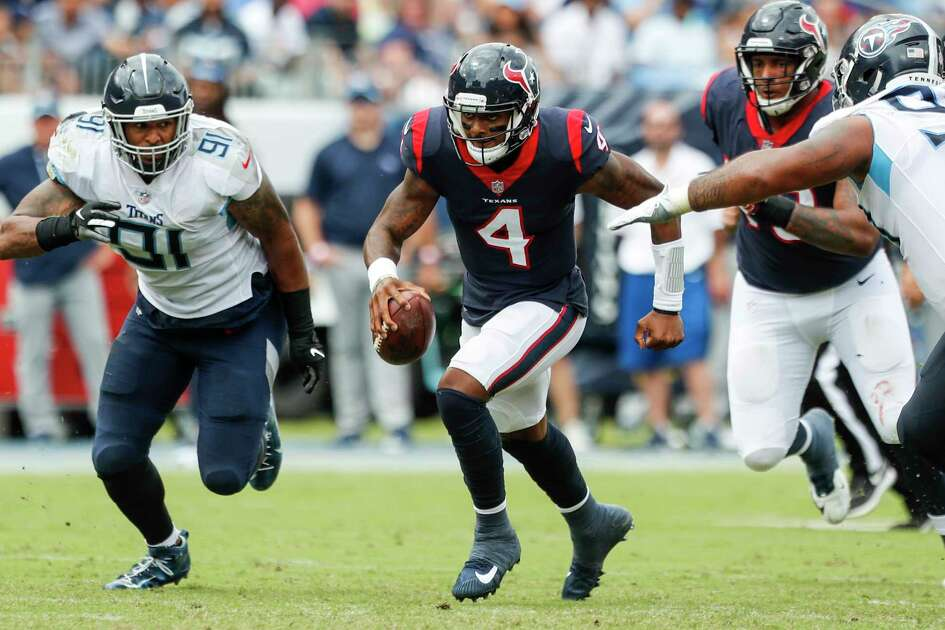 Houston Texans quarterback Deshaun Watson (4) is chased out of the pocket by Tennessee Titans linebacker Derrick Morgan (91) during the second quarter of an NFL football game at Nissan Stadium on Sunday, Sept. 16, 2018, in Nashville.